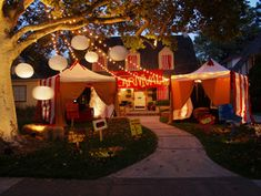 "Creepy Carnival Tents for an Outdoor Halloween Theme: Designer Michelle Buckley shares her ideas for creating an unusual experience this Halloween: Turn your front yard into a creepy sideshow spectacle using pop-up tents to mimic the feel of a travelling carnival. Faux carnival tents offer a distinctive backdrop in this bid for the neighborhood's spookiest yard. Materials and Tools: pop-up canopy tents with fabric sidewalls, 9 red table runners (86"" X 18"") 5 yards red rayon fabric, 5 y..."