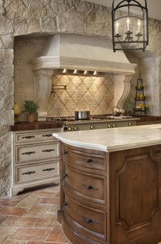 KITCHEN – Design Features That Bring Spanish Flavor to a Kitchen  Cook up a fresh take on old-world style in your kitchen with these ideas for mixing in Spanish-style materials and architectural details