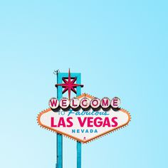 "The iconic ""Welcome to Las Vegas"" sign against a clear blue sky."