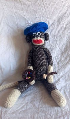 This sock monkey is ready to paint a masterpiece.  What do you think it will be?