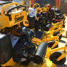 A line of Wright Stander mowers ready to go into the store.