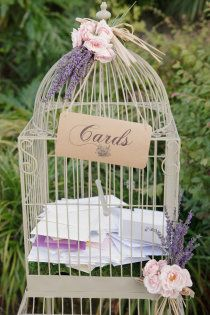 sweet birdcage for your wedding gifts ornate with lavender & pink spray roses