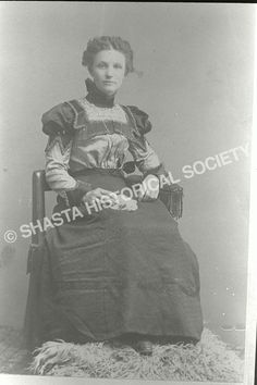 Bland, Carrie Tuggle sitting in her wedding dress (no date given, though she was born in 1877) Shasta Historical Society