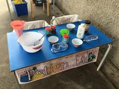 A dramatic play/science area for students to use water and different food stuff to make their own 'potion'.