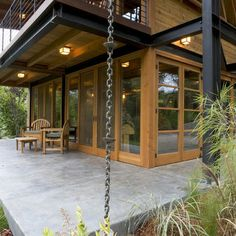 Rain Chain - instead of an ugly plastic downspout to drain the rain, snowmelt from your roof! COOL!