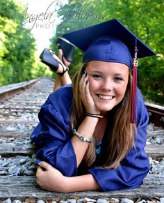 This is a creative way to take graduation pictures and the way the trees are blurred in the background makes the focal point clear. Girl Graduation Pictures, Graduation Picture Poses, Graduation Portraits, Graduation Photography, Graduation Photoshoot, Senior Picture Outfits, Girl Senior Pictures, Grad Pics, Senior Girls