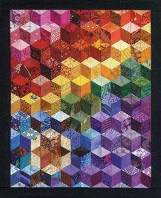 I made a tumbling blocks throw quilt several years ago. I love it, but thought I was going crossed eyed before I was through.