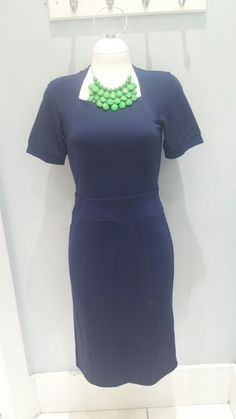 Mikarose Harper dress in navy $59.99, also available in blue and red. Necklace by Bijou Michelle $23.99.