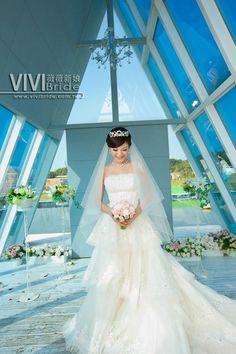 A beautiful bride, in a beautiful dress, in a beautiful chapel.