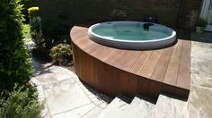 Patio area and decked area with a hot tub in this garden. Garden completed by our member Groundteam Limited, see more of their great work here - https://www.experttrades.com/trade/groundteam-limited/gallery  #garden #patio #outdoorhottub #hottub #gardenideas #gardendesigns #home #inspiration
