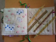 A Fidget Item - usually a quilt or apron - has various items and texture patches attached to keep restless fingers busy, touching and playing with the