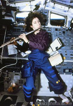 From first Latina in space, to head of the Johnson Space Center: Astronaut Ellen Lauri Ochoa, STS-56 mission specialist, takes a brief time out from a busy day in space to play a 15-minute set of flute offerings on the space shuttle Discovery's aft flight deck. Ochoa, who has played the flute for 25 years, performed the Marine Corps Hymn, Navy Hymn and God Save the Queen for fellow crew members as well as some Vivaldi for herself. (Courtesy NASA)