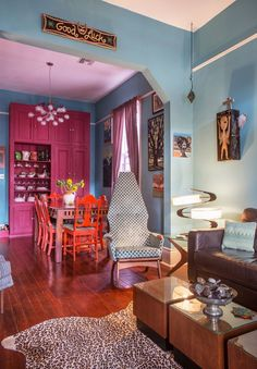 """The couple's vast collection of folk art covers the interior walls like a modern day version of the storied Parisian salons. """"We like to pile it on thick,"""" Emily says with a laugh. New Orleans Decor, New Orleans Homes, Exterior Color Combinations, Fairytale House, Shotgun House, Interior Decorating, Interior Design, Decorating Ideas, Decor Ideas"""