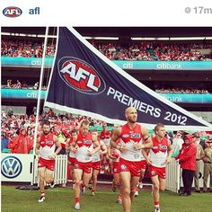 Ted Richards (150 games) leads the Sydney Swans out after the unfurling of the premiership flag #goswans #Sydney swans   by tanjay81 (instagram)