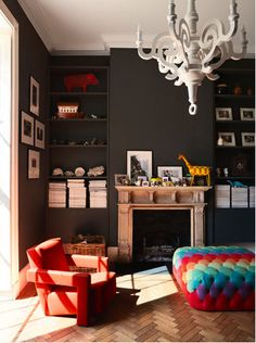 Dark walls colorful furniture - I like that idea. I feel you'd need a lot of light in the room though