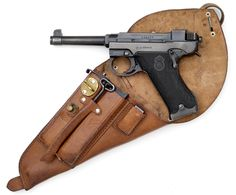 Excellent condition Husqvarna Lahti semi-auto pistol with original holster, Swedish, World War II.