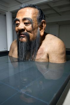 """Q Confucius No.2″ by Chinese artist Zhang Huan is a massive, life-like statue of Confucius. Crafted from steel, silicone, carbon fiber, and acrylic"