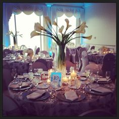 Flowers By Amore- cala lily centerpiece with blue lighting