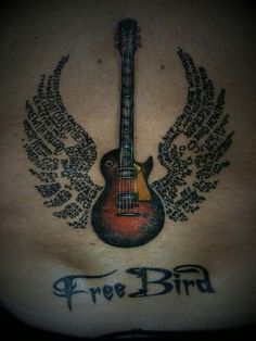 Free Bird tattoo. Favorite song by Lynyrd Skynyrd. Love how the lyrics make up the wings of the guitar.