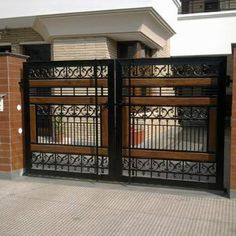 Varieties house gate design that can be appropriate for a person house gate design iron gate AXLRFVR Iron Main Gate Design, Grill Gate Design, House Main Gates Design, House Window Design, Steel Gate Design, Front Gate Design, Door Gate Design, Latest Main Gate Designs, Gate Designs Modern