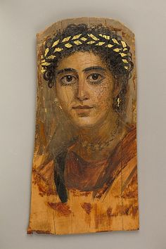 Funerary portrait of a young woman, partially gilded encaustic paint on limewood panel, AD 90-120, Egyptian. Metropolitan Museum of Art accession no. 09.181.6
