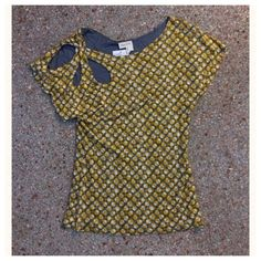 Sale🎉NWT. Top from Anthropologie. NWT. Meadow Rue short sleeve top from Anthropologie.  A cute vintage print, This top is lined in grey and adds weight and drape.  The tag can be cut and the top is reversible. There are no holes, tears, stains, snags, or pilling. From a pet friendly environment. Anthropologie Tops