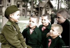 Very young Soviet soldier 1945 tells orphans about his combat experiances