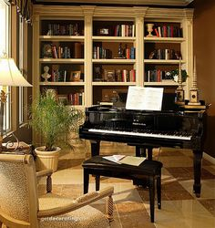 Love this music room - tile for acoustics, built-ins... what's not to love?
