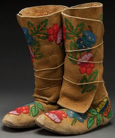 A PAIR OF NEZ PERCE BEADED HIDE HIGHTOP MOCCASINS