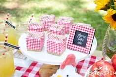 Fill gingham favor boxes with something sweet, like striped mints, or something savory, like a homemade BBQ rub.