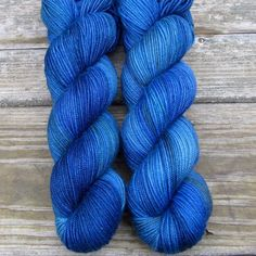 Bright navy blue with a variety of shades of green blended in, named for the beautiful and shady Blue Ridge mountains that are right in our backyard. This colorway is a Babette: every skein and every
