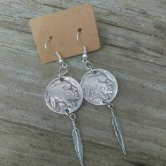 Check out this item in my Etsy shop https://www.etsy.com/listing/245946168/coin-earrings-feather-earrings-american