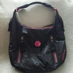 JUICY COUTURE PURSE Super nice black nylon bag with pink lining and accents. Large front pocket with turn lock closure and 2 front zipper pockets.  1 huge zipper pocket inside and 2 multi-function slots.  Seat belt type handle. This bag is in great condition and would also be good as a student book bag or diaper bag etc... Ask for more pictures if needed. Juicy Couture Bags