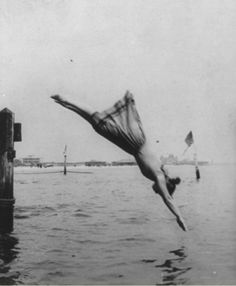 Woman diving off of pier; Early 1900s. Photographer unknown.