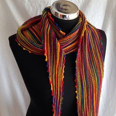 This shallow triangle-scarf is perfect for easy knitting while you catch-up with friends at knit night. Designed to show-off hand-dyed yarns, it allows the beautiful colours to shine.