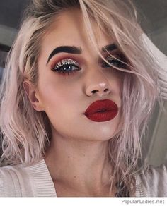 Glam makeup with red and glitter