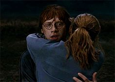 Ron looks so surprised at first then he happily accepts the fact that she's hugging him