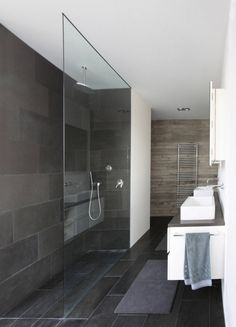 big slate tiles. glass wall. bathroom./ n-lab architects