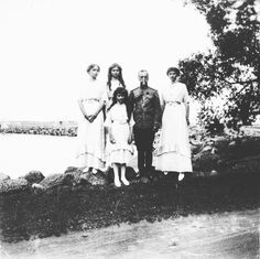 Emperor Nicholas II of Russia with his daughters c. 1913. by historyofromanovs