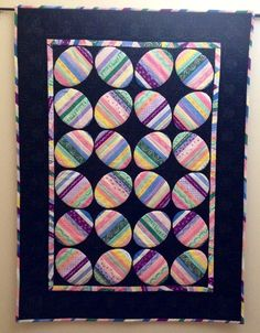 Easter Egg Quilt by Irene Miller - lots and lots of machine embroidery stitches here.