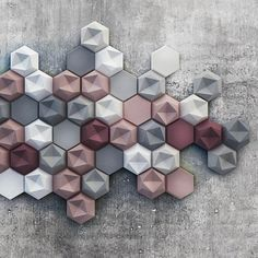 Edgy by Kaza Concrete | Designed by Patrycja Domanska and Tanja Lightfoot | A collection of modular elements in concrete produced by Hungarian manufacturer Kaza Concrete, Edgy consists of two kinds of hexagonal tile, one with a smooth surface and the other with a three-dimensional asymmetric surface. They can be applied to both interior and exterior surfaces, covering walls either fully or partially.