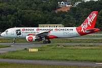 AirAsia (MY) Airbus A320-216 9M-AFW aircraft, painted in ''AirAsia Mobile App'' special colours Feb. 2014 & the stickers ''BOOK-MANAGE-CHECK-IN, available on-IOS/BB/ANDROID/WINDOWS/PHONE'' on the airframe, skating at Malaysia KotaKinabalu International Airport. 16/05/2014.