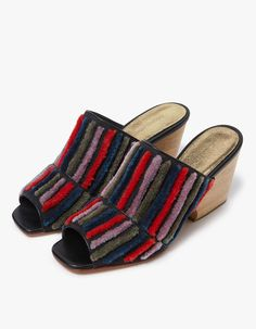 Peep toe mule from Rachel Comey in Multi Stripe. Fuzzy, embroidered details at vamp. Leather lining. Tonal stitching. Lightly padded footbed with embossed logo. Sculpted, wood heel with rubber cap.   • Textile upper • Leather sole • Women's sizes list