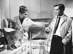 """""""Breakfast at Tiffany's"""" is a 1961 American romantic comedy film directed by Blake Edwards and written by George Axelrod, loosely based on Truman Capote's novella of the same name. Starring Audrey Hepburn and George Peppard, and featuring Patricia Neal, Buddy Ebsen, Martin Balsam, and Mickey Rooney"""