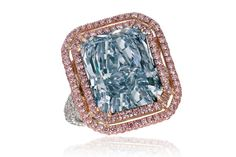 """""""The Lumina"""" ring featuring a rare, 12.38-carat radiant-cut blue diamond, surrounded by a double halo of pavé-set pink diamonds. Jacob & Co."""