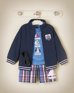 Dress him in nautical sailboats and plaid, perfect for vacation getaways.