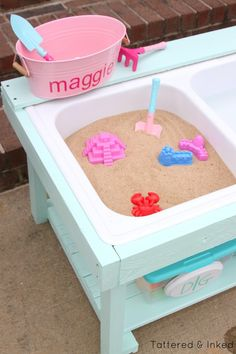 DIY sand and water table for under $50! by Tattered and Inked featured on @Remodelaholic