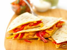 A quesadilla (pronounced ke-sah-dee-uh) is a Tex-Mex dish that involves cooking ingredients inside tortillas. I find children like eating tortillas - one of the reasons is that they can eat them with their fingers. You can add other ingredients to this, such as some shredded cooked chicken. To serve, you can use a bought salsa or guacamole.