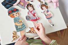 The cutest fabric with dolls and clothes to cut out for my girls to play with!