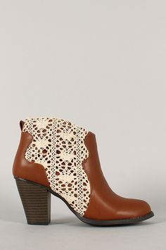 Give your feet a little treat with this super chic and stylish bootie. Featuring round toe, crochet side panels, stitching accents, and stacked heel. Finished with padded insole and smooth interior lining for all day comfort.
